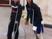 Adam and Johar on crutches