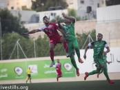 Gaza Strip's Shejaiya's player (green) vies with Hebron's Al-Ahly's player (red) during their return leg football match for the Palestine Cup final, August 14, 2015 at Hussein Bin Ali Stadium in the West Bank city of Hebron.  Hebron's Al-Ahly won 2-1, in the first footballing showdown in 15 years with a team from Israeli-blockaded Gaza to be proclaimed Palestinian champions. Al-Ahly will now represent Palestine, a member of football's world governing body FIFA since 1998, in international competitions.