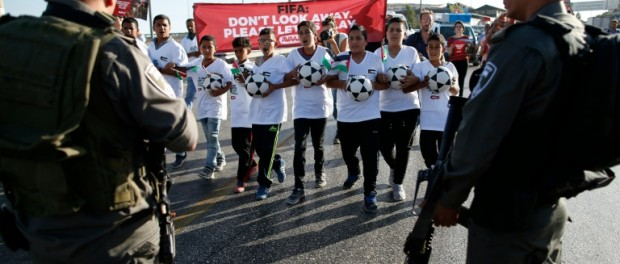 Palestinian youths march on settlement in message to FIFA